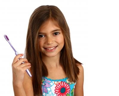 Smiling Girl with a Tooth Brush